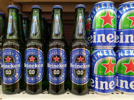 Non-alcoholic version of Heineken glass bottles and Aluminum can 0.0 beer on shelf in supermarket at Chiang Mai - THAILAND, February 12, 2021 Editöryel