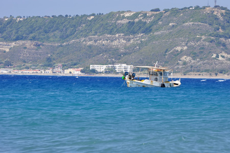 old ship floating in the blue sea photo