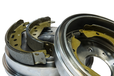 Brake shoes and drums on a white background