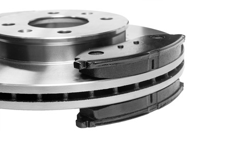 Consumables: brake pads adjacent to the brake disc Stock Photo