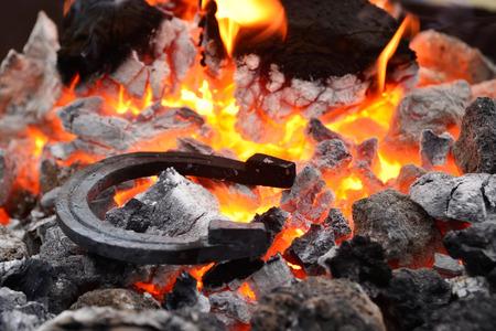 shop skill: iron horseshoes lying on hot coals and burning flame