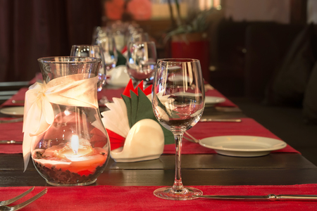 glasses and a candle on a table in a restaurant photo