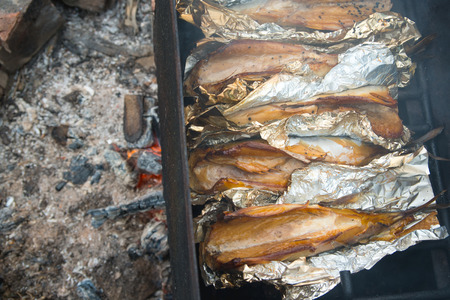 fish fire: Smoked fish on fire