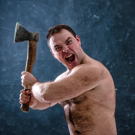 hairy: Angry aggressive man brandishing an ax