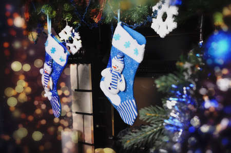 mantelpiece: Blue socks for gifts above the fireplace on Christmas Stock Photo