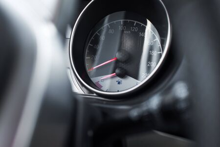 depth measurement: Car speed meter with fuel level with shallow depth of field Stock Photo