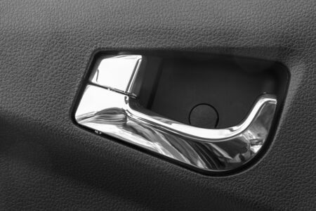 inconvenience: Car door opening handle on a white background