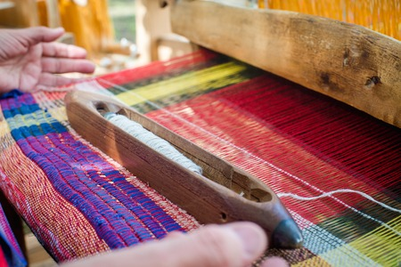 weaving: Weaving the threads on old wooden loom