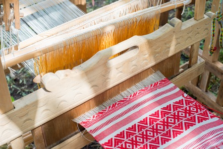 rug weaving: a piece of cloth with a small depth of field woven in a loom
