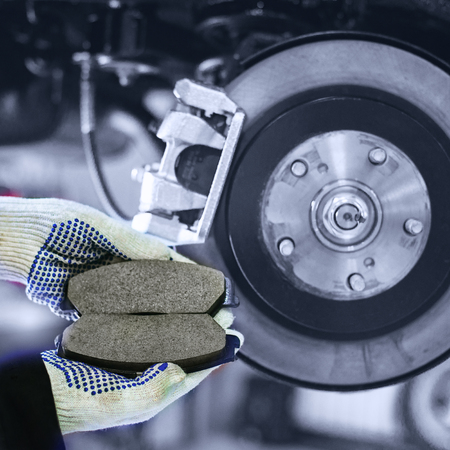 hands hold brake pads with shallow depth of field 写真素材