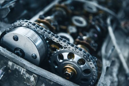 chain and gears of a car engine with a shallow depth of field Stock Photo - 131914499