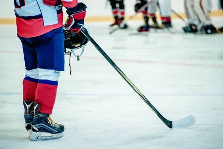 hockey player and stick at shallow depth of field