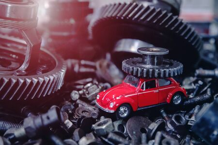 red car on the background of old spare parts