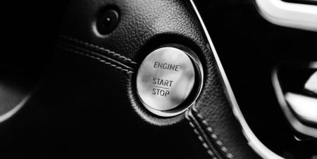 button start stop engine business car at shallow depth of field