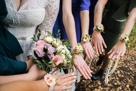 Flower bracelets with roses and silk ribbons. Stock Photo