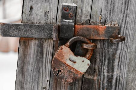 Old lock on a wooden door with shallow depth of field Banco de Imagens