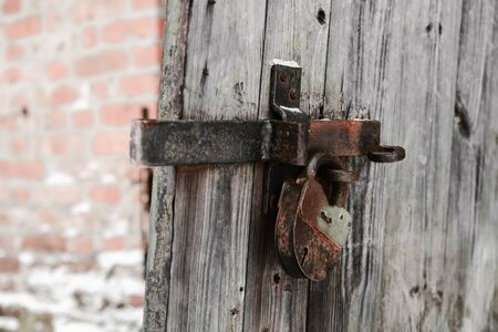 old lock on a wooden door with shallow depth of field