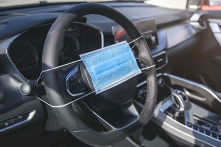 protective mask on the steering wheel of a car