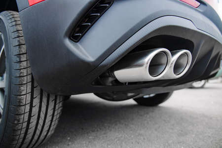 new dual chrome pipe car exhaust at shallow depth of field