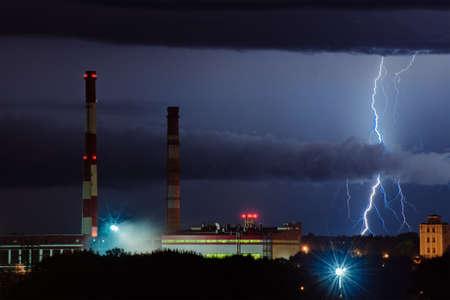 Thunderstorm. Lightning in the night sky near the factory
