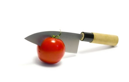 Japanese deba knife cutting red tomato