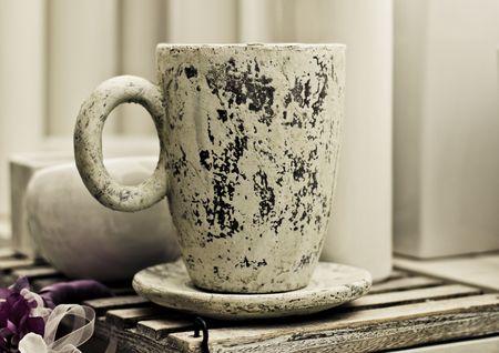 Aged coarse white stone cup. photo