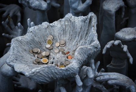 coin in lotus leaf Stock Photo