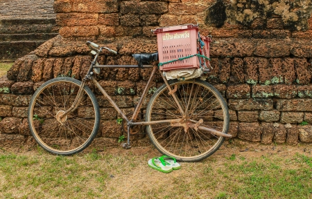 the old bicycle and castle rock of thailand Stock Photo