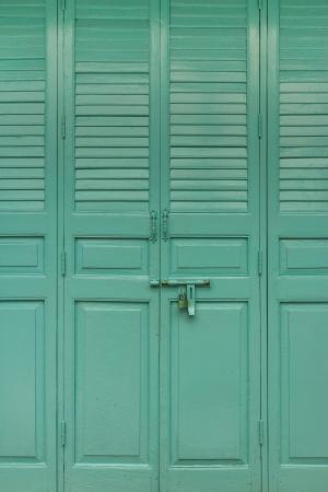 green door of thai style wat suthat of thailand photo