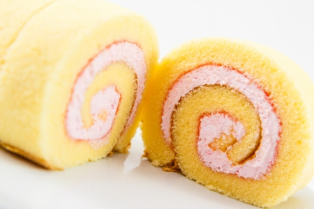 Strawberry cake roll sweet and delicious on white background.