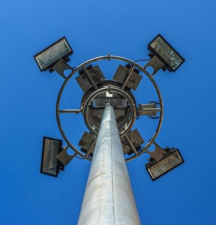 Stadium light pole with blue sky