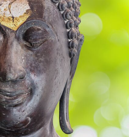 Close up buddha portrait and abtract background