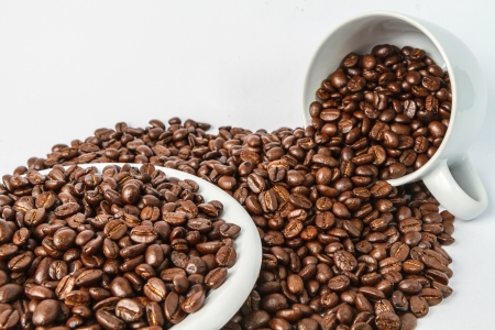 Coffee cup and coffee beans isolated on white Stock Photo