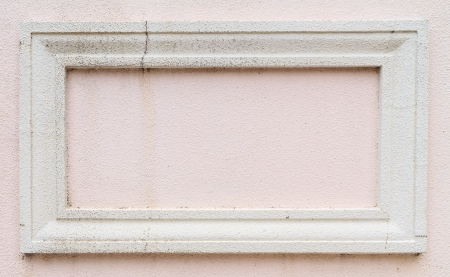 white frame on pink wall photo