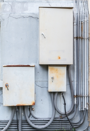 old electric boxs on wall Stock Photo