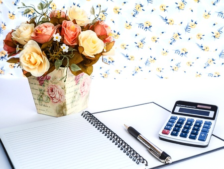decolate flower and business object on table