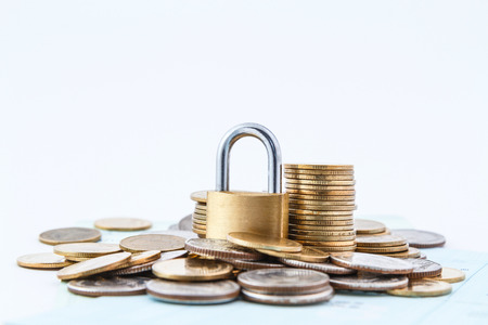 coins stack lock concept and white background Stock Photo