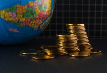 gold coins on book  and global