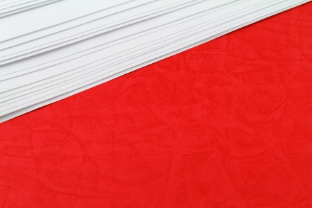 red cardboard and white paper space for text photo