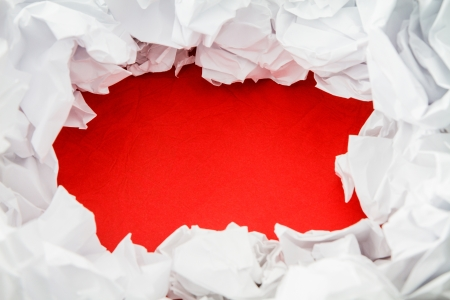 Crumpled white paper  and red cardboard space for text photo