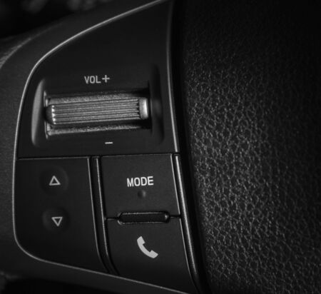 Audio control buttons on  steering wheel of a modern car