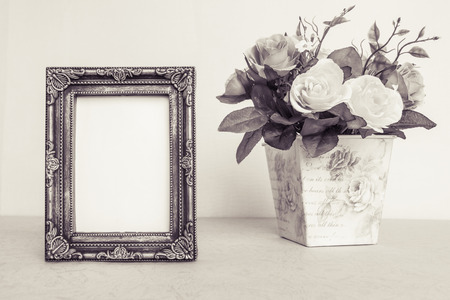 Vintage frame and rose decoration