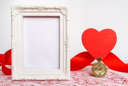 Vintage frame and red heart photo