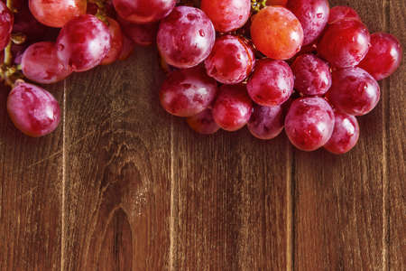 red grapes on wood background Stock Photo