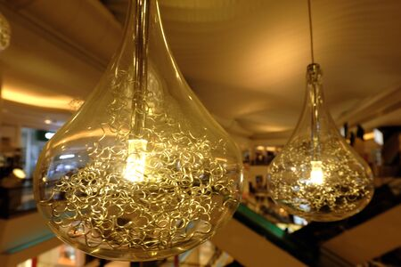 Light Bulbs Decoration In Cafe Shop. New Ideas Concept Thinking Innovation Business Solutions.