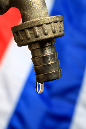 Water drop with Thailand flag background photo