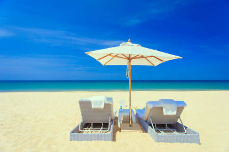 Sunbed and umbrella on the beach photo