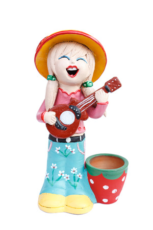 girl doll playing the guitar doll made from baked clay in Thailand photo