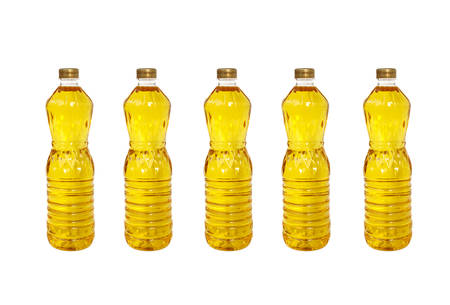 A bottle of Palm kernel Cooking Oil, isolated on white background photo