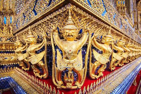 Golden garuda statues at Wat Phra Kaew in Grand Palace, Bangkok, Thailand photo